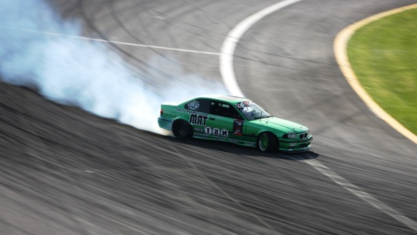 Chelsea DeNofa's mean green BMW roasting the tires